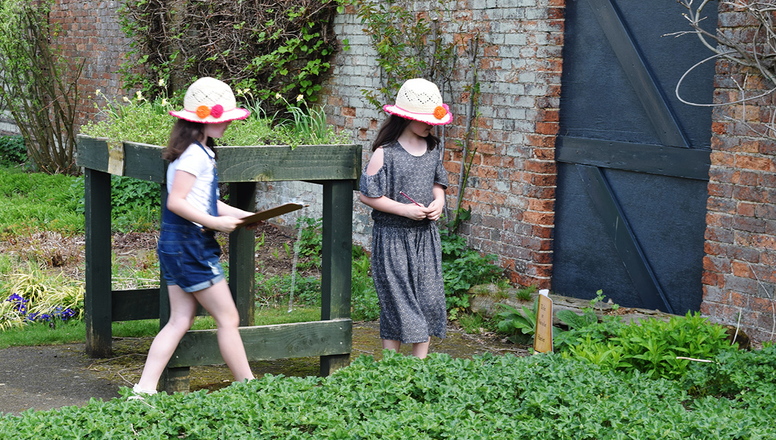 Children exploring the walled garden