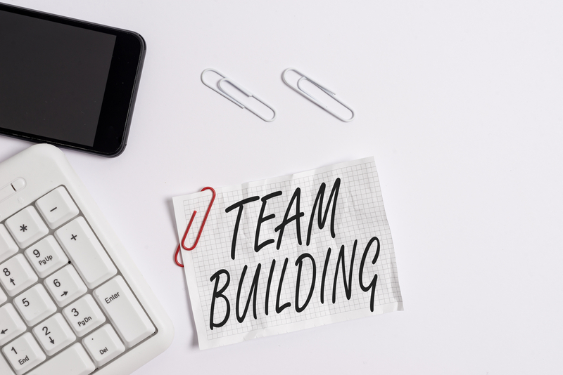 white background with the text 'team building'